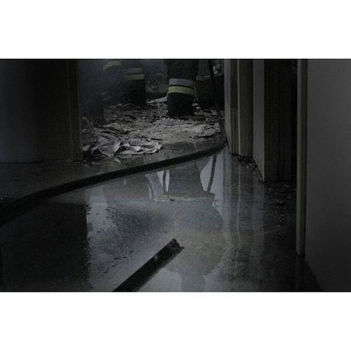 SOUTH AFRICA, FREE STATE, BLOEMFONTEIN: The reflection of a fire fighter is seen in water on the floor of a building that almost burned down. Fightingfires Firefighter Fire Work Photojournalist Lovephotography  Eye4photography  Photojournalism Mycameraandi Canon Awesomepoeple Blackandwhite Smoke Flamesandwater