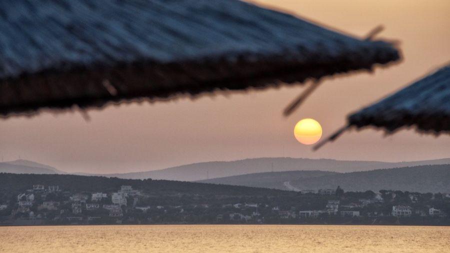 Sunset in Çeşme Izmir ❤ Izmir Turkey Izmirlife Izmir Cesme, Turkey Çeşme Sky Scenics - Nature Nature No People Beauty In Nature Tranquil Scene Water Sunset Sun Mountain