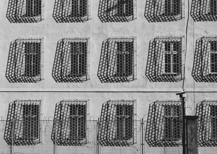 Architecture Built Structure Building Wall - Building Feature Building Exterior Window Repetition Bnw_collection Bnw_captures Bnwphotography Bw_collection Bw_lover BW_photography Windows Shadows & Lights Shadow And Light