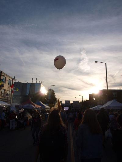 Balloon Balloon Hair Accessories Festival Getting Lift In Your Hair Hair Raising Experien Outdoors Sky Street Festival Sunset On Street Scene Taken Away