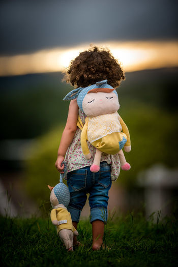 Child Childhood Nature Full Length Real People Casual Clothing Focus On Foreground Plant Lifestyles One Person Leisure Activity Toy Water Carrying Hairstyle Teddy Bear Women Outdoors