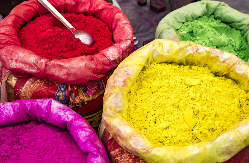 High angle view of multi colored powder paint for sale in market