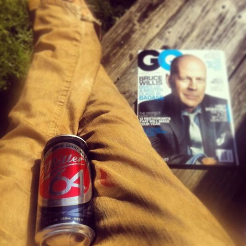 Enjoying this beautiful day with a cold one and my GQ. Millertime GQ Backdeck