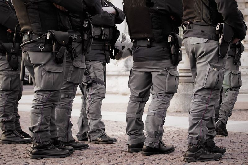 Low section of police men standing on footpath