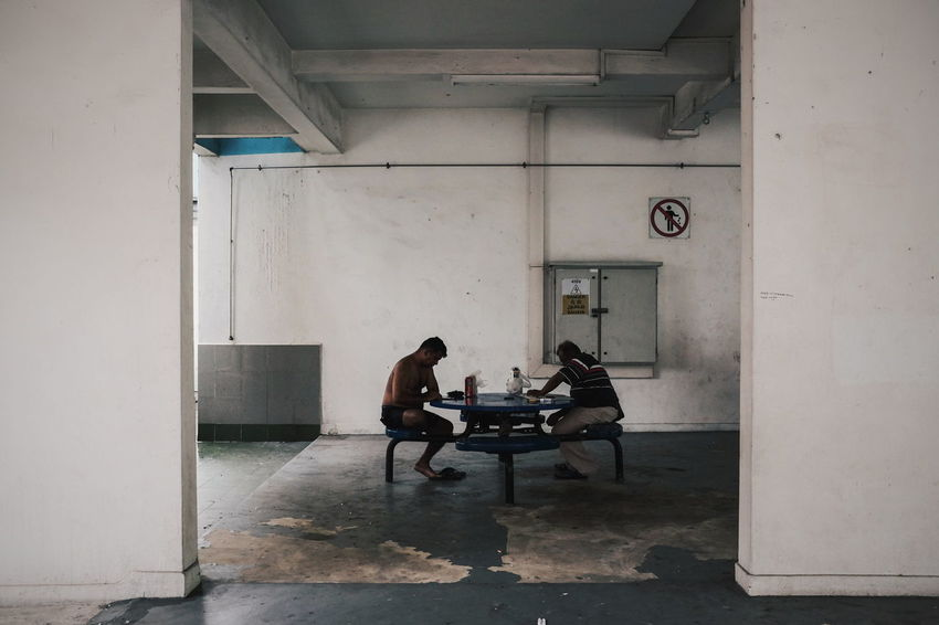 Void Deck People Man Sitting Common Area Table Bench Drinking Beer Reading Newspaper Indian HDB Residential Area Flats Street Photography Streetphotography Streetphoto_color Street Life Everybodystreet FUJIFILM X100S