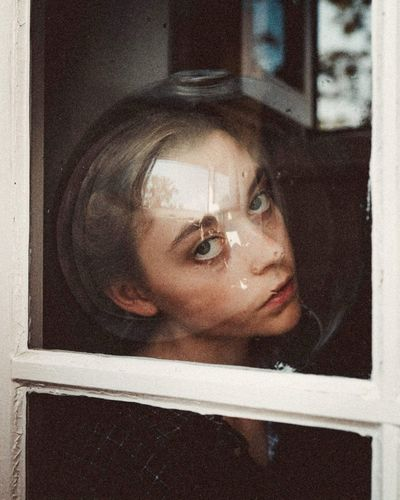 Portrait of woman with reflection in mirror