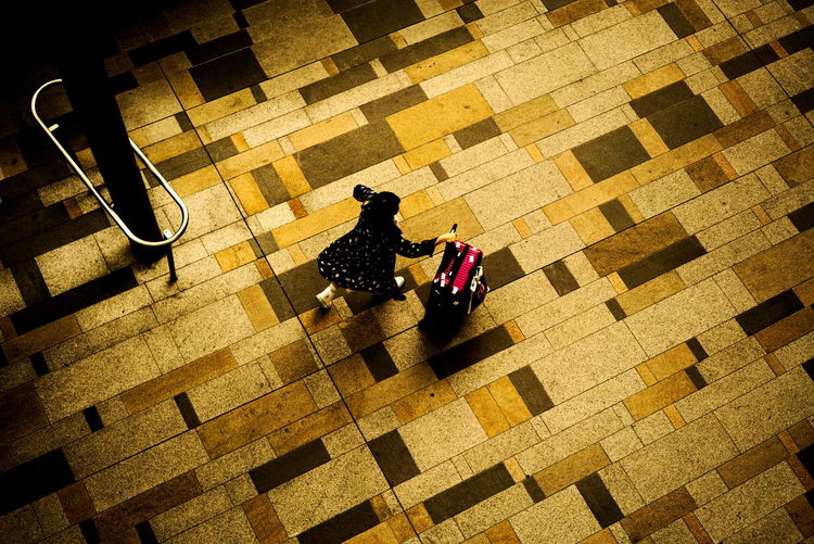 Tokyo Day High Angle View Indoors  Real People Street Photography Tiled Floor Woman With Suitcase