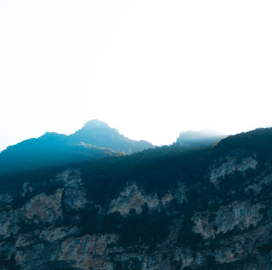 Low angle view of mountains against clear sky