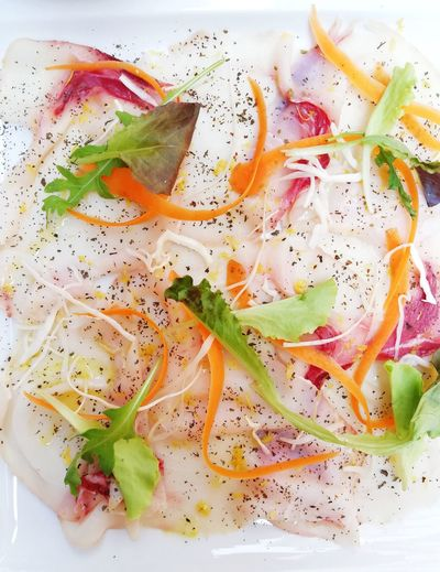 Delicious and colorful fish carpaccio ready to be eaten Fish Raw Food Raw Carpaccio Italian Food Gourmet Delicious Tasty Lunch Lunch Time! Dinner Time Dinner Food And Drink Italian Colorful Vegetables Healthy Eating Healthy Lifestyle Dieting Multi Colored Abstract Close-up Served Prepared Food Serving Size Dish Ready-to-eat Sushi Plate Salad