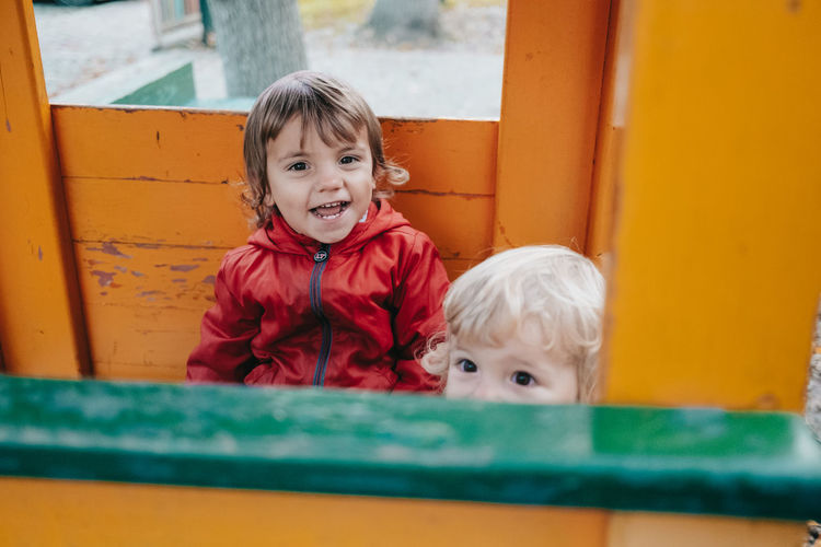 Portrait of smiling boy with sister