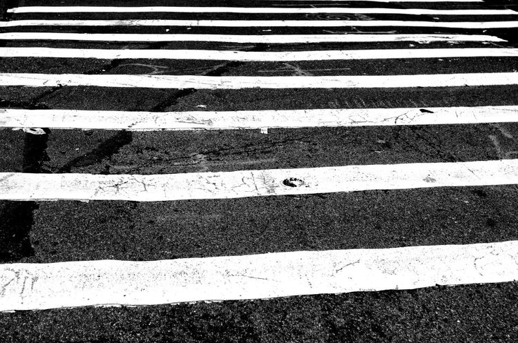 NYC Series - PTRN (instagram: @iamjosway) Asphalt Backgrounds City Crossing Crosswalk Day Full Frame High Angle View Marking No People Outdoors Parallel Pattern Road Road Marking Safety Sign Street Street Photography Streetphotography Striped Symbol Transportation Zebra Crossing The Street Photographer - 2018 EyeEm Awards The Traveler - 2018 EyeEm Awards