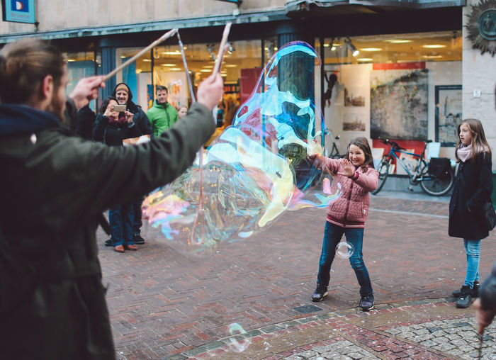 Baloons Bubbles Children Day Happiness Human Hand Mature Adult Men Only Men Outdoors People Portable Information Device Soap Bubbles Togetherness Young Adult Enjoy The New Normal