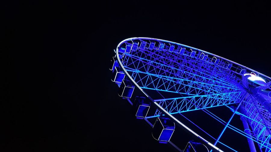 Low Angle View Reisenrad #Blue Neon Lights Evening Night Ride Amusement Park Amusement Park Ride Illuminated Ferris Wheel Amusement Park Ride Amusement Park Nightlife Sky Big Wheel Fairground