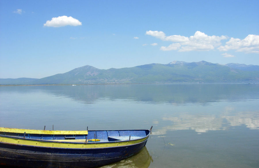 lake prespa in macedonia Beauty In Nature Boat Day Lake Lake Prespa Macedonia Mode Of Transport Moored Mountain Mountain Range Nature Nautical Vessel No People Ohrid Lake Outdoors Scenics Sky Tranquil Scene Tranquility Tranquility Scene Transportation Water Waterfront