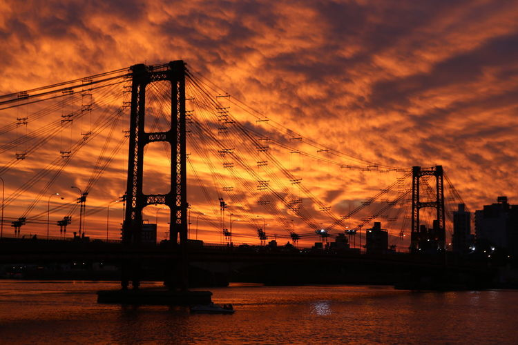 Puente Colgante Argentina Beauty In Nature Cloud Cloud - Sky Cloudy Crane - Construction Machinery Development Dramatic Sky Hidden Gems  Home Is Where The Art Is Moody Sky No People Orange Color Outdoors Santa Fe Scenics Sky Sun Sunset Tranquil Scene Tranquility Weather