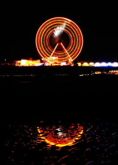 The Blackpool big wheel / ferris wheel at night. Beach Big Wheel Blackpool Blackpool Beach Blackpool Big Wheel Blackpool Pier Dark Fairground Ferris Wheel Ferris Wheel Funfair Illuminated Light Trails Long Exposure Low Angle View Night Reflection Reflection Reflections Tourism Travel Destinations Water