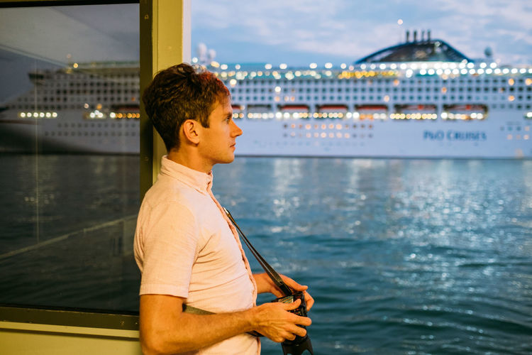 Venice Water Real People Leisure Activity One Person Nautical Vessel Transportation Young Men Young Adult Lifestyles Standing Mode Of Transportation Architecture Looking Away Sea Nature Focus On Foreground Casual Clothing Looking Outdoors Contemplation Looking At View Cruise Ship