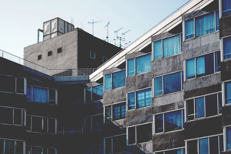 Architecture Building Exterior Built Structure Window Low Angle View City Building Development Clear Sky Repetition Blue Day Construction Building Story Sky No People Office Building Modern