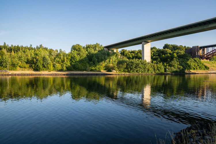 Beautiful Nature Nord Ostsee Kanal Reflection Architecture Bridge Bridge - Man Made Structure Built Structure Clear Sky Connection Day Kiel Landwehr Light And Shadow Nature No People Nordostseekanal Plant Relaxing Moments Shadow Sky Sun Sunset Tranquil Scene Tranquility Water Capture Tomorrow