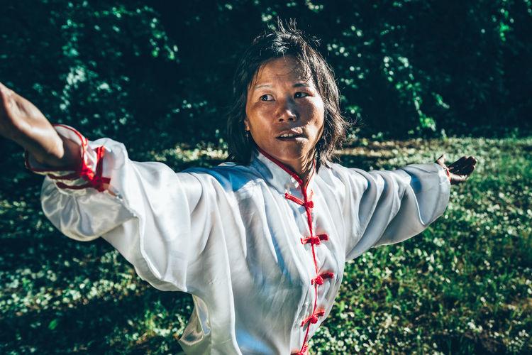 Mature woman practicing martial arts at park