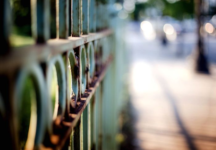 Selective Focus Railing Surface Level Focus On Foreground Diminishing Perspective No People Architectural Feature Fineartphotography Fine Art Photography Artistic Photography Pilsen Pilsen Neighborhood Artwalk Iron Wrought Iron Chicago Green Blur
