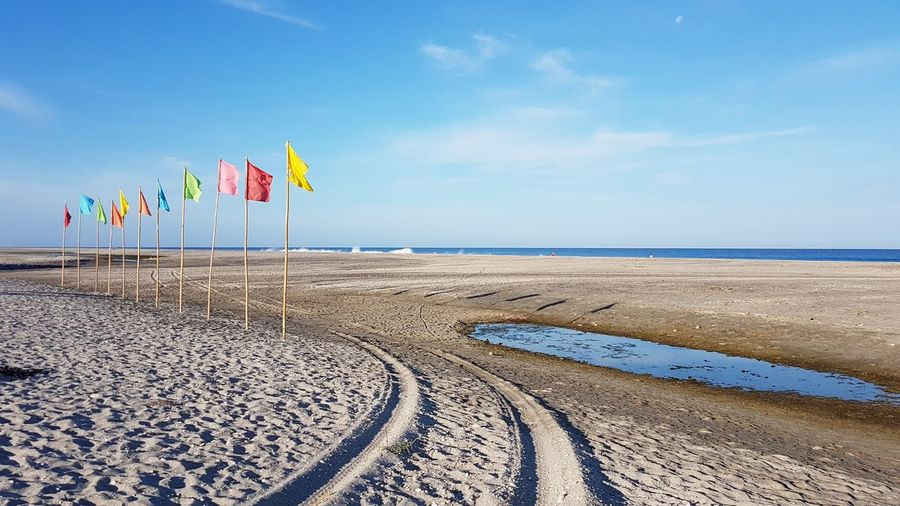 EyeEm Selects Beach Sea Sand Sky Flag Outdoors Day Horizon Over Water Travel Destinations Nature Travel Vacations Tranquility No People Blue Summer Water Landscape Beauty In Nature Eyeem Philippines Travel Travel Photography Swimming Nature Sommergefühle EyeEmNewHere Lost In The Landscape