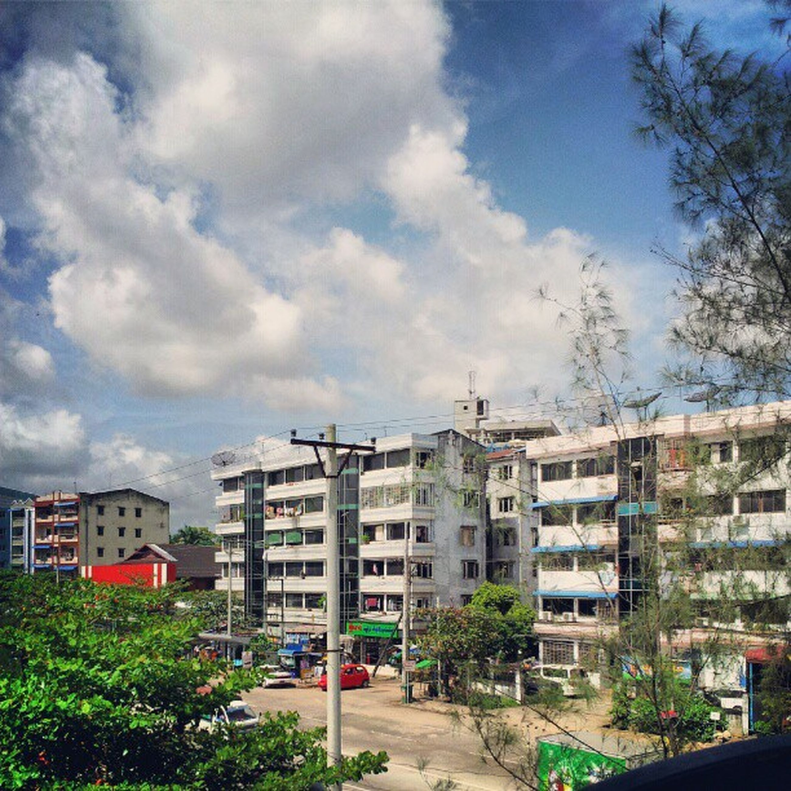 building exterior, architecture, built structure, sky, residential building, residential structure, house, tree, city, building, residential district, window, street, cloud - sky, day, cloud, outdoors, road, town, no people