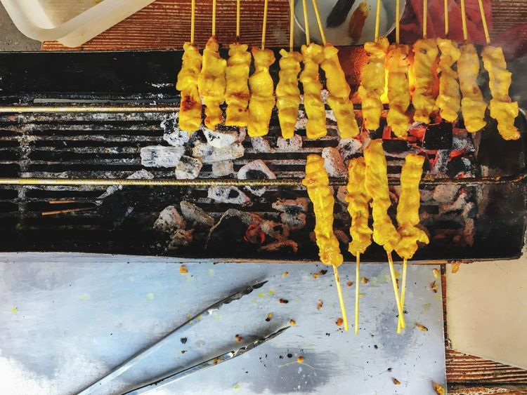 Grilled pork satay ASIA Delicious Grilling Top View Of Food Top View Streetfood Pork Satay Grill Food And Drink Food Yellow No People Healthy Eating Day Food Stories