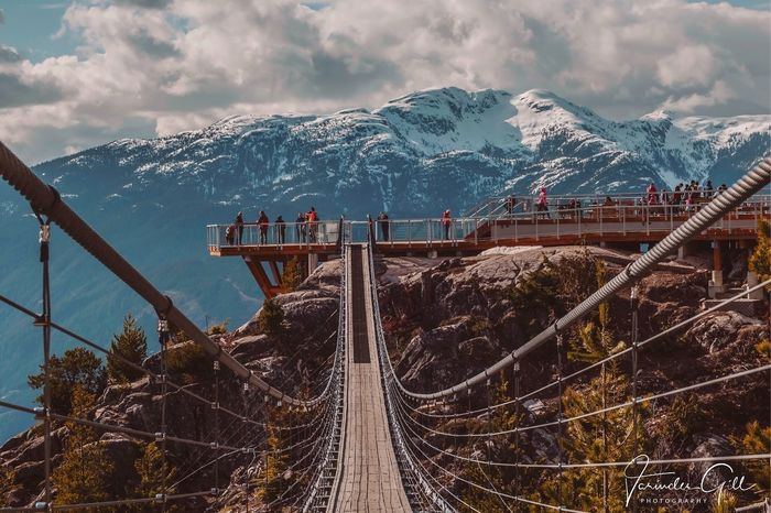 Anything you want is on the other side of fear Canonphotography Canon Photographer Photography Photo Wanderlust Bridge Suspension Bridge Mountain Cloud - Sky Sky Architecture Snow Nature Summer Exploratorium Snowcapped Mountain Mountain Range Day Beauty In Nature Outdoors