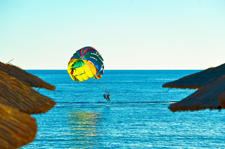 Parasailing. Alternative Fitness Beauty In Nature Blue Blue Wave Calm Clear Sky Day EyeEm Best Shots Horizon Over Water Idyllic Niklasskur Ocean Paragliding Parasailing Popular Photos Rippled Scenics Sea Seascape Showcase April Sky Tourism Tranquil Scene Vacations Eyeemphoto