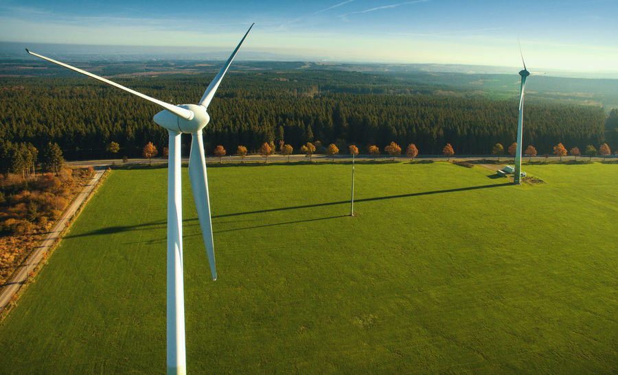 Alternative Energy Beauty In Nature Day Field Fuel And Power Generation Grass Green Color Industrial Windmill Landscape Nature Outdoors Real People Renewable Energy Sky Wind Power Wind Turbine Windmill