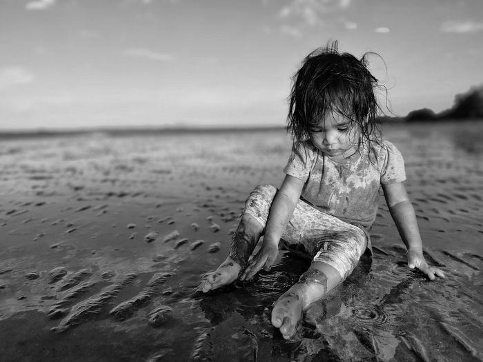 Full length of girl at beach against sky