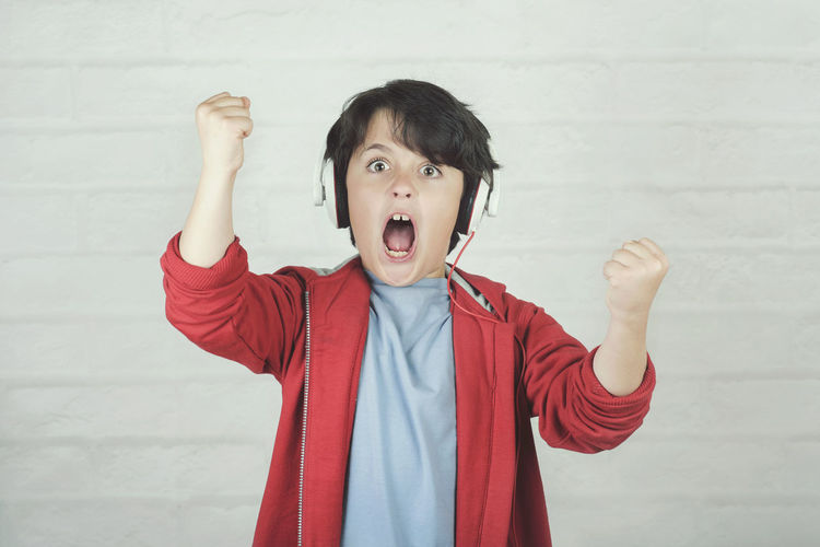 Shouting Child Portrait Excitement Childhood Accessory Headphones Music Audio Song Listening To Music Melody Sound Winer Success Mp3 Player Happy Happiness Emotion Feeling Artist Singer  Expression Singing Fun Euphoric Lifestyle Shout Euphoria Gesticulate Gesture Talent Concert Entertainment