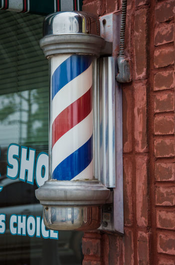 Barber Pole Barber Shop Blue Brick Building Exterior Day No People Outdoors Red Spiral Striped Swirl Tradition