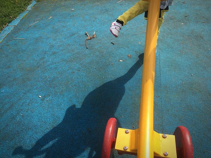 Low section of child playing on playground