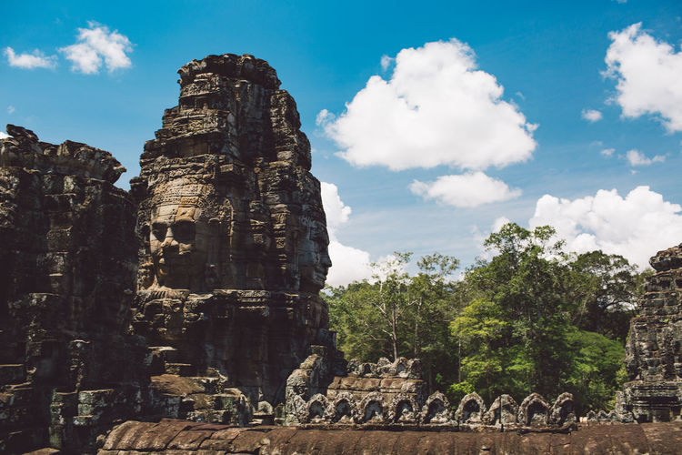 Siem Reap Cambodia Angkor Sky Cloud - Sky Travel History The Past Nature Day Tree Travel Destinations Rock Tourism Architecture Ancient Plant Built Structure Solid No People Rock Formation Low Angle View Outdoors Ancient Civilization