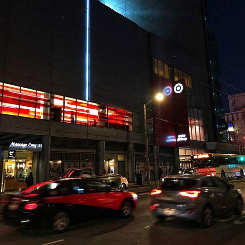 Cars on illuminated city at night