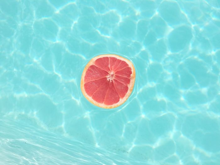 High Angle View Of Fruit Floating On Swimming Pool