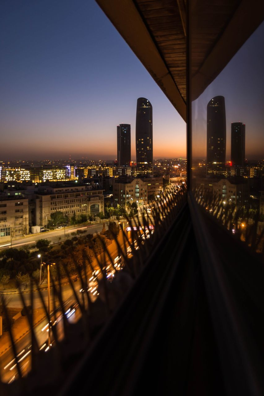 architecture, built structure, building exterior, city, connection, illuminated, transportation, no people, skyscraper, cityscape, sky, night, outdoors
