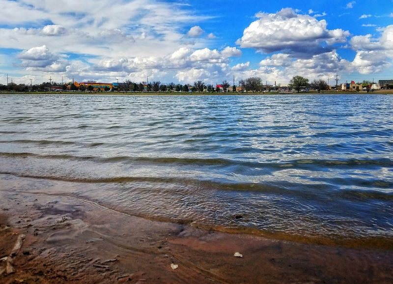 Water Reflection Sky Cloud - Sky Outdoors Beach Lakeshore Lakeside Lake Nature Day Sand Scenics Tree Beauty In Nature No People Architecture