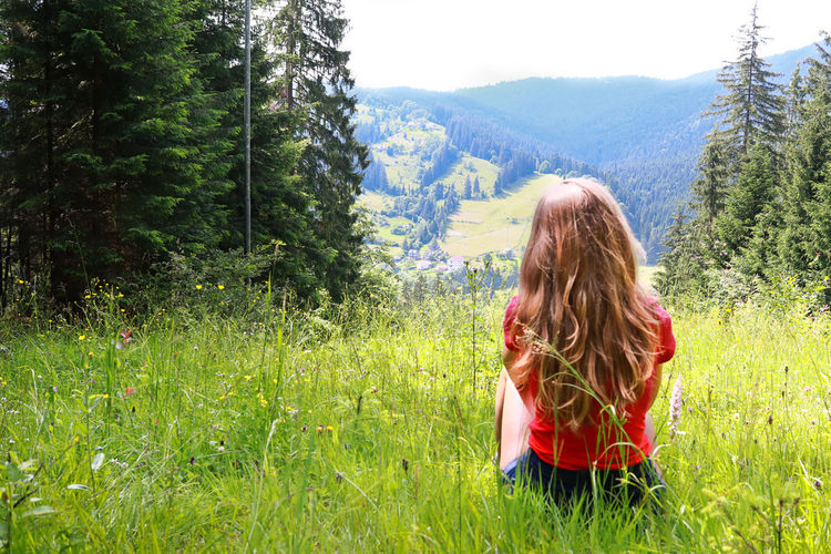 Girl On The Grass Mountain View Karpatian Summertime Green Grass Blue Sky First Eyeem Photo