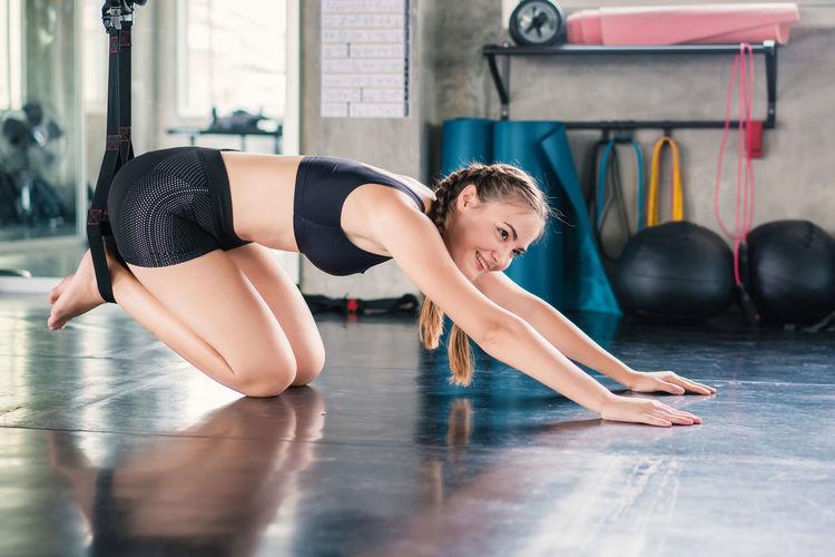 Full length of woman lying on floor