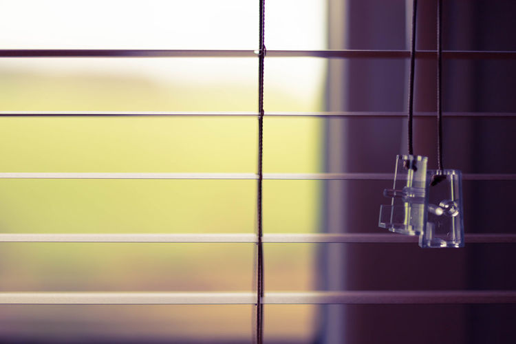 close-up of illuminated lights hanging on wall Built Structure Close-up Day Februar Flooring Focus On Foreground Glass - Material Hanging Household Equipment Illuminated Indoors  Lighting Equipment Metal Music No People Shape Tile Transparent Wall - Building Feature Window