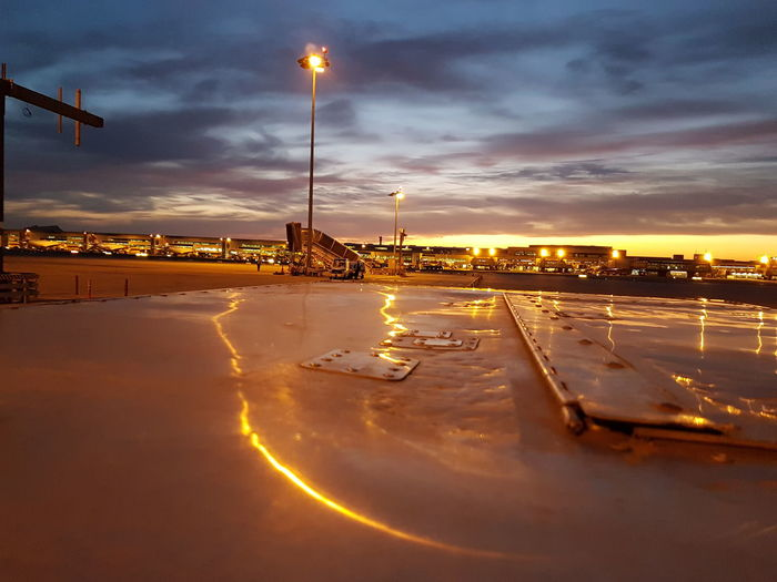 Illuminated lisbon portela airport against sky