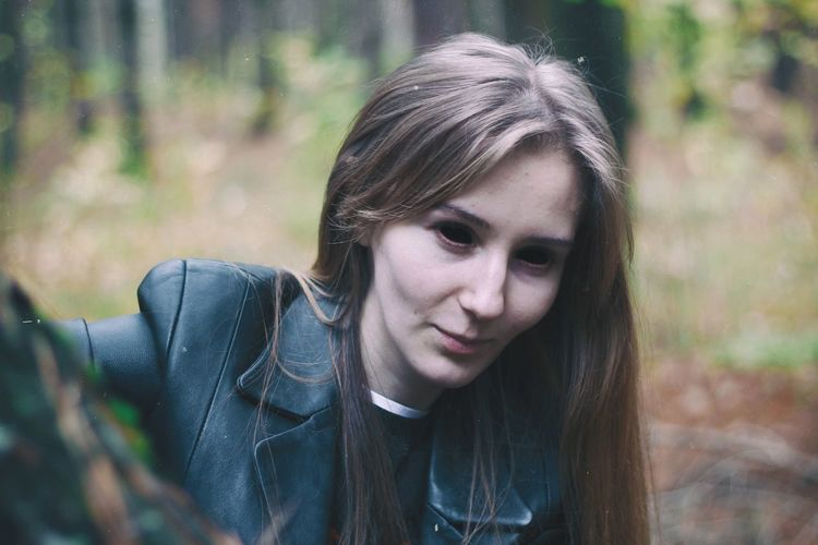 Close-Up Of Woman With Spooky Eyes In Forest