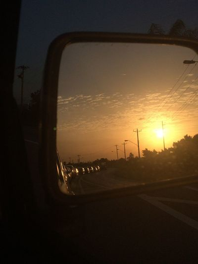 Sunset Transportation Car Mode Of Transport Land Vehicle Vehicle Interior Sky Travel Road No People Sunbeam Silhouette Car Interior Clear Sky Side-view Mirror Outdoors Sun City Tree Nature