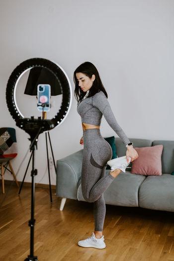 Full length of woman standing on hardwood floor