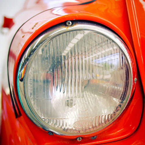 Car Transportation Land Vehicle Headlight Motor Vehicle Mode Of Transportation Close-up Metal Retro Styled Vintage Car Red Shiny Chrome Wheel Reflection No People Vehicle Part Day Focus On Foreground Antique Silver Colored