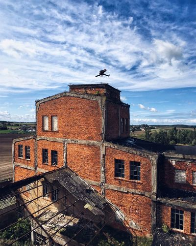 Jumper Urbex Mine Abandoned Brick Wall Flying Rooftop Clouds And Sky EyeEm Selects Done That.
