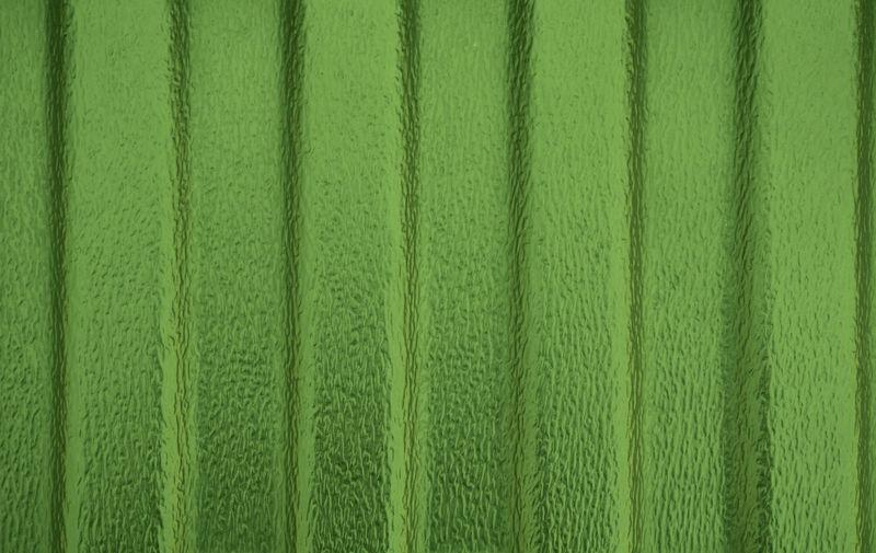 Full frame shot of textured green wall